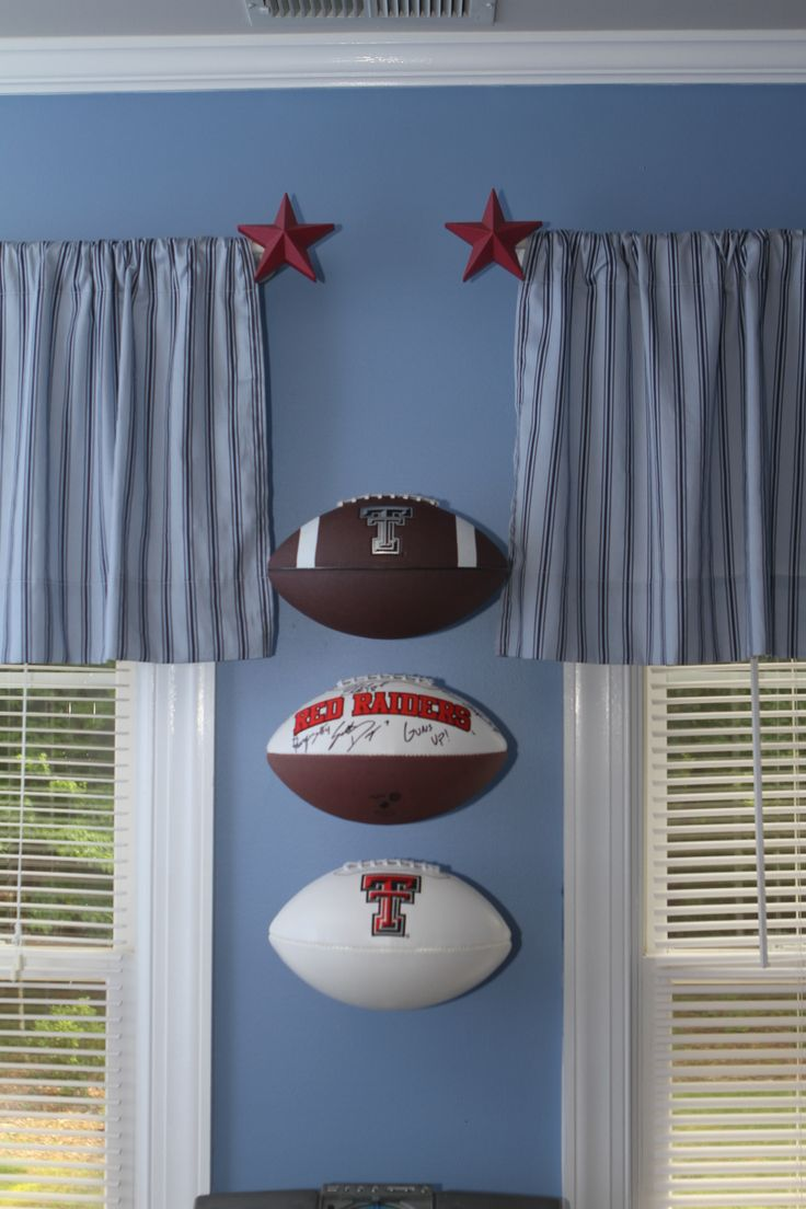 footballs on the wall   stacked invisi ball wall mount