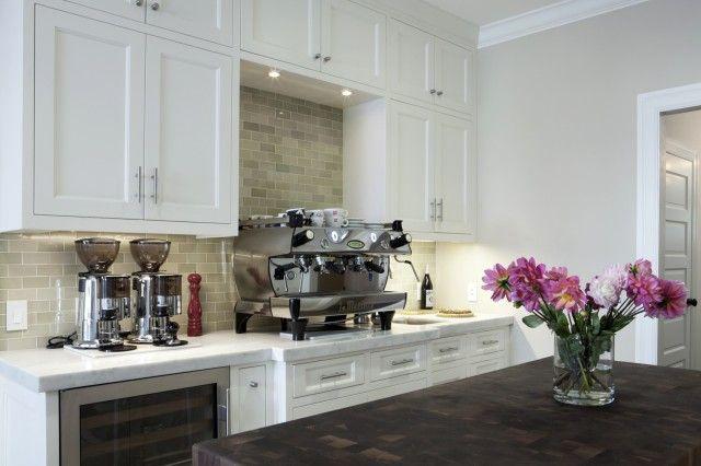 clean and elegant: white shaker cabinets, glass tile backsplash, marble countertops