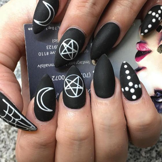 With moons, stars and constellations, this acrylic nail art is simply stellar.