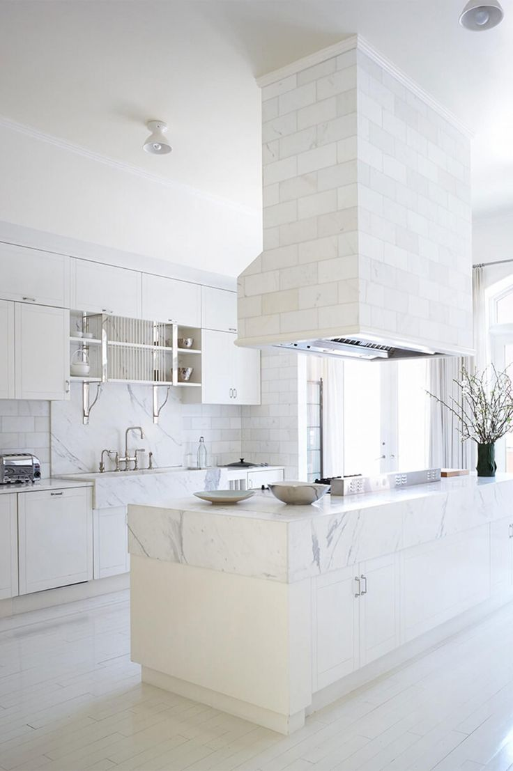 Gwyneth Paltrow's New York kitchen is understated yet totally glamorous. The white marble counters are timelessly chic, and the stainless steel fixtures look so striking against them. Photo courtesy of Bjorn Wallander/Goop.