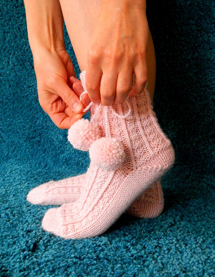 Pink wool socks with pom poms. So soft and snug, great for sleeping! The textured pattern is very simple, using only knits and purls. Short rows heel.