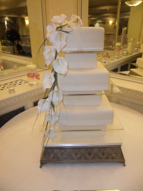 6 tier ivory covered wedding cakes with orchid flower spray | Flickr - Photo Sharing!