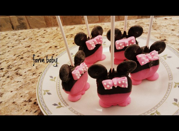 Minnie Mouse Oreos ***ingredients (Oreo cookies, lolipop sticks, black candy coating, pink candy coating)