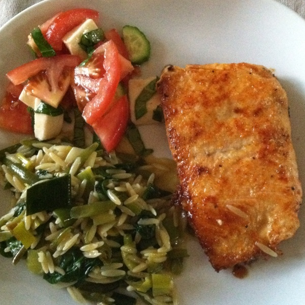 Honey-butter salmon; orzo pasta simmered in broth, sautéed with spinach leeks, garlic, frenchcut green beens; tomato, cucumber, basil and fresh mozzarella sprinkled with sea salt and olive oil.