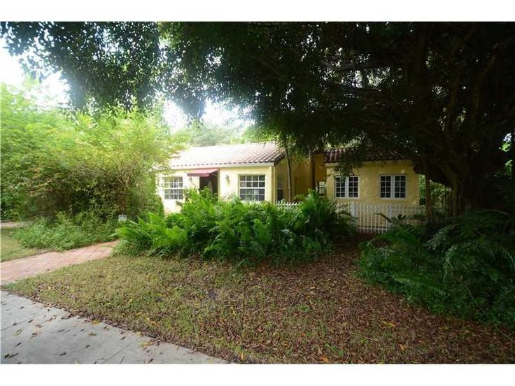 Miami Shores, updated Mediterranean home on a classic tree lined street. The Main house, with 3 bedrooms 2 baths includes a recent master suite addition with cathedral ceilings. Situated in the lush, tropical, native landscape garden is a charming cottage with a 3rd full bath. New Kitchen, granite counters, Farmhouse Sink, Marble floor, and Pantry/ Washer/Dryer alcove. Original details include beamed pecky cypress ceilings, brick fireplace, rustic doors, hardwood floors,