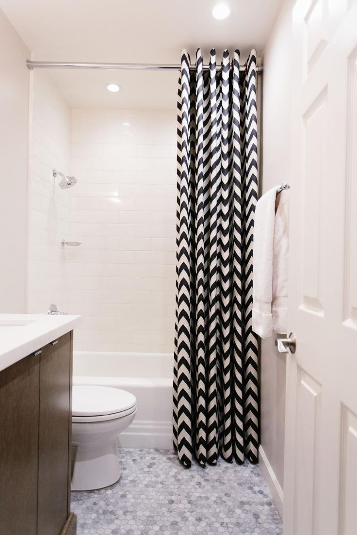 Out+of+the+way+but+not+forgotten,+this+small+white+bathroom+with+a+black+and+white+chevron+shower+curtain+is+merry+and+bright.+Keeping+a+pristine+look+to+the+approach,+Pure+Interiors+Design+enlarged+the+space+without+sacrificing+its+attractiveness.+It's+fun,+playful+and+inviting.+