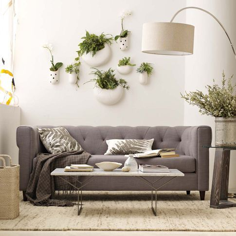 wall of plants.: Wall Art, Westelm, Grey Couch, Living Rooms, Living Wall, Hanging Plants, West Elm, White Wall, Wall Planters