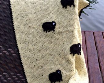 Wool knit baby blanket. Soft alpaca pastel pale yellow with crocheted black sheep applied. Newborn baby hand made blanket. Baby shower gift. $140