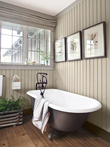 Like the planter & the walls! Rather than hide the guest bathroom's custom-painted Sunrise Specialty tub behind a shower curtain, Laurie opted for a faucet with hand-shower attachment by Newport Brass. The paneled walls are painted DKC-12 by Donald Kaufman.    Read more: Rustic Lake House Decorating Ideas - Cabin Decor Ideas - Country Living