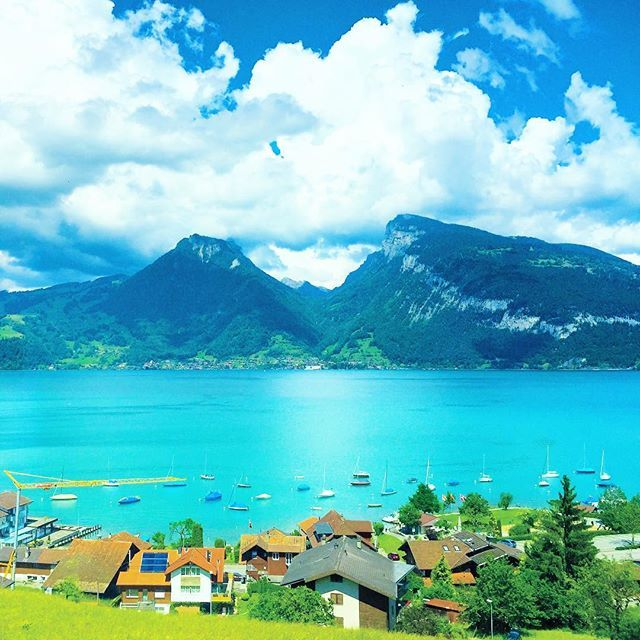 Entire Switzerland is beautiful  This pic is of Lake Thun, Interlaken, taken from a superfast train while travelling to Luzern from Interlaken. We strongly recommend to try out train rides.   Be it trains between Zurich and Interlaken or between Zurich and Milan(Italy), we had separately planned out these train rides as part of our trip. ...........  ..... #thetravelspeak #travelblogger #switzerland #lakethun #europe #eurotrip #train #eurorail #travel #traveling #traveltips