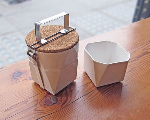 This beautiful ceramic Tiffin Lunch Kit was designed by Lorea Sinclaire and stacks on top of itself to create both storage and a serving surface (a natural cloth elastic strap keeps it all in place).