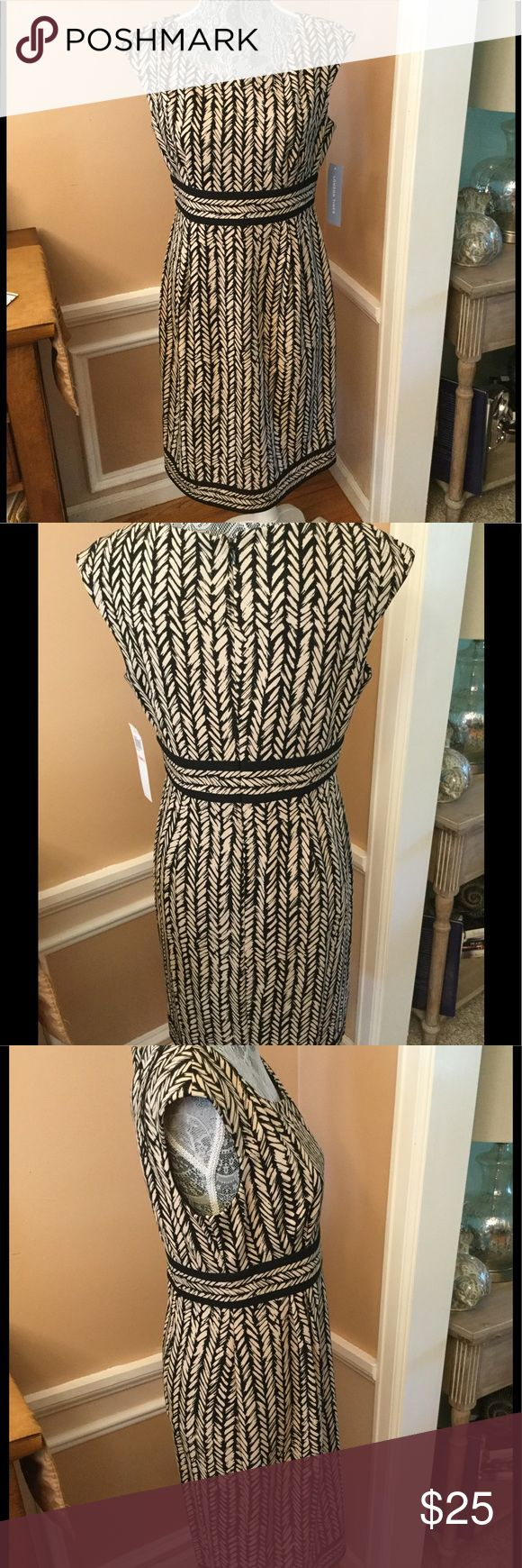 "NWT TAUPE AND BLACK GEOMETRIC HY WAISTED DRESS This low neck dress , has a wide waist band, which also has the same design on bottom of dress. back zipper. 96% polyester, 4% spandex. Dry clean only. Bust 38"", hy waist 31"", length 38"". Very stunning. London Times Dresses Midi"