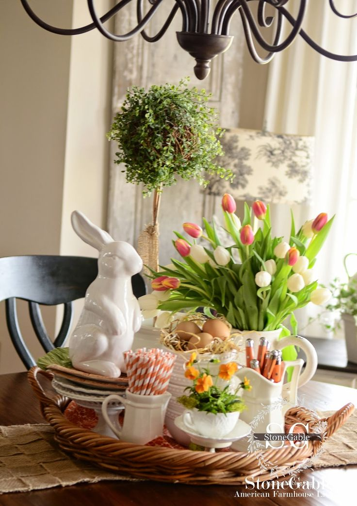 SPRING FARMHOUSE KITCHEN VIGNETTE. Great centerpiece on Easter buffet with large white rabbit in this white and green with pops of orange table.