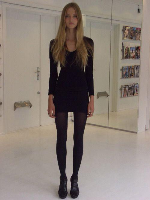 Simple tight black long-sleeved dress