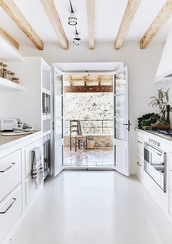 Have Doors with windows in it leading to the patio to bring the outdoors in