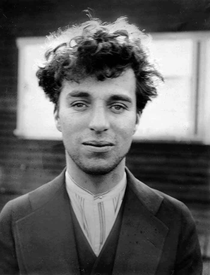 Charlie Chaplin at age 27, in 1916. I never watched Charlie Chaplin movies, but this is the first picture I've ever seen of him without his trademark mustache and make-up.