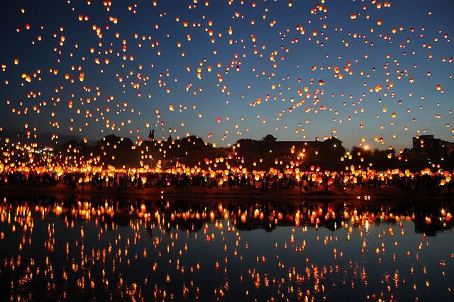 """Every year, on the first day of astronomical summer, there are thousands of people gathering at the river of Warta in the Polish city of Poznan, to celebrate and share this meaningful momment. Its importance and joy is expressed by lanterns flying into the sky."" Text and photo by Adam Brosz"