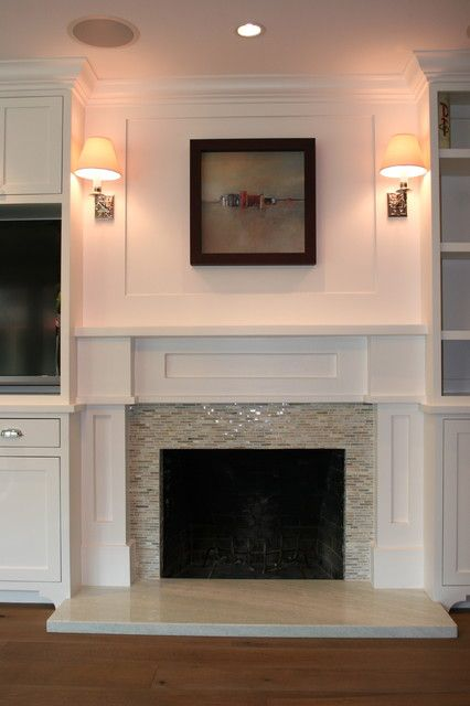 Glass Tile Fireplace Design, Pictures, Remodel, Decor and Ideas  Square tiles date a home. The glass tiles would be a great, easy update!!  Sconces too. Lovely.
