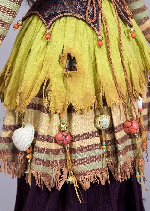 Make a Fairy Skirt with a Tattered, Stained Hemline Embellished with Dangling Fairy Treasures - great tutorial