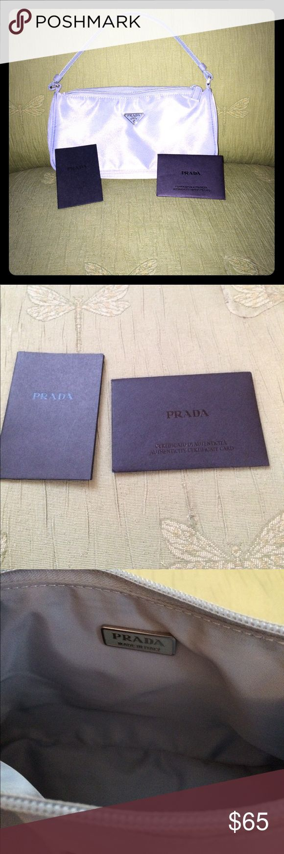 Prada Tessuto Sport Great starter Prada purse for those who like a small lightweight bag. The color is listed as pervinca which is a blue/gray. Comes with certificate of authenticity card. Prada Bags