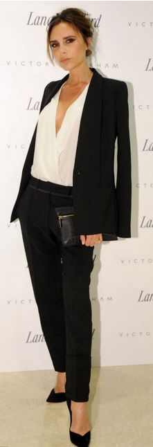Victoria Beckham: Shirt, jacket, pants, and purse – Victoria Beckham Collection  Shoes – Casadei: