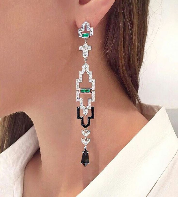 Dare to dangle in @nikoskoulisjewels! Exquisite architectural #earrings with Art Deco #emeralds, bold black enamel and glittering #diamonds today.
