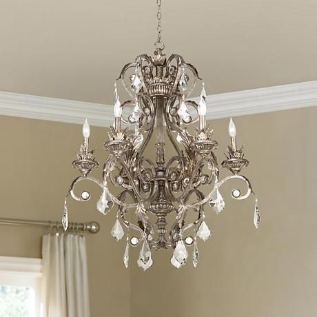 This beautiful metallic silver chandelier features intricate floral details and shimmering crystal accents.