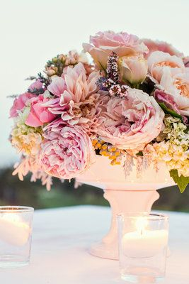 pastel centerpieces glowing at an outdoor wedding #wedding #flowers #centerpieces