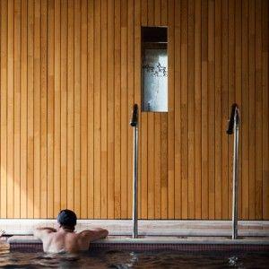 Virgula I adds warm wood to  white-walled Portuguese hotel