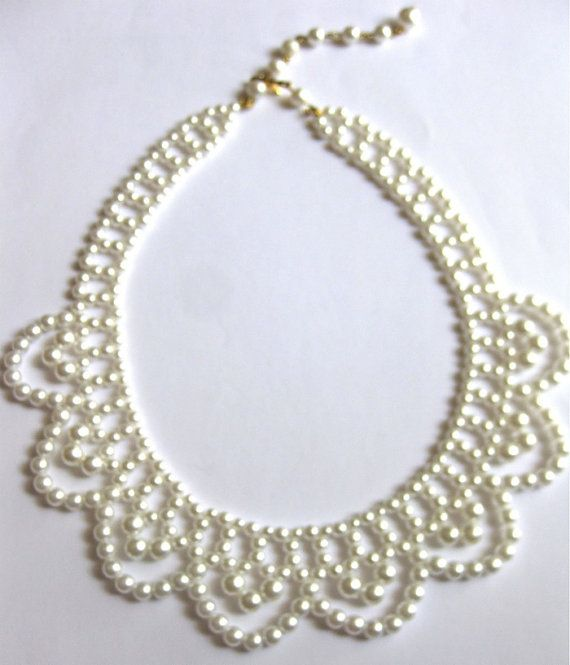 Beautiful vintage choker/necklace has multiple size white pearls and has a scalloped design. It is adjustable as shown in photo. This measures from 16