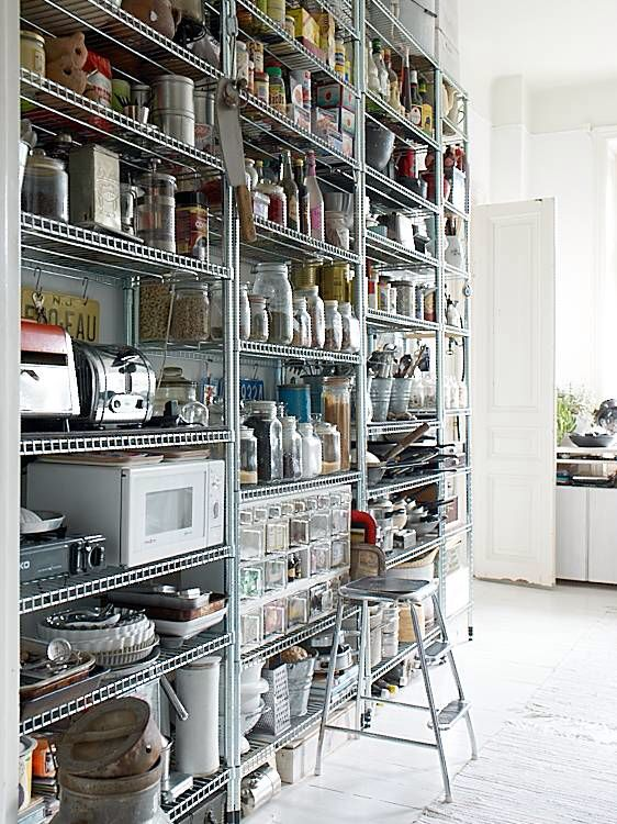 Huge stainless steel industrial shelves make great display storage if you have a big empty wall.