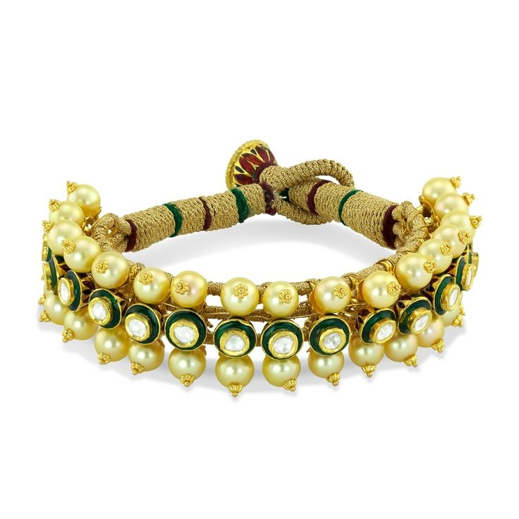 Rajasthani Bracelet | Devam Jewelry. A Rajasthani inspired treasure crafted in delicate 22k gold with care and tradition in mind. Green meenakari, brilliant polki diamonds, and lustrous golden pearls glitter exquisitely. Each piece of the bracelet is carefully threaded onto the band, creating an enchanting wonder for many years to come.