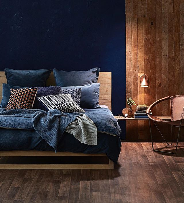 Today we'll be bringing you two different bedroom looks. This one starts strong with a deep midnight wall and moody blue bedlinen, balanced by raw timber and natural tan leather accents. Double tap if you this look, and hit the link in our profile to shop. Styling @thehangoverchef Photo @denise_braki #templeandwebster #bluebedroom #bedroomstyling