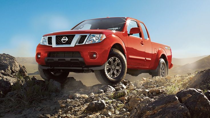 2017 Nissan Frontier off-roading, shown in Lava Red