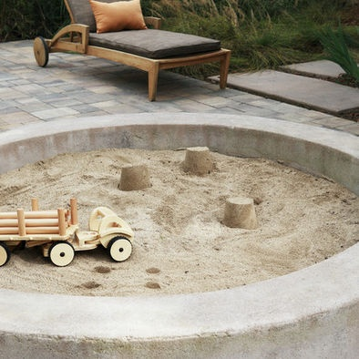 sandbox. I love that it is concrete.  No slivers, no rot.
