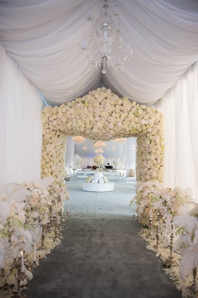 white and pink roses line this dreamy wedding entrance
