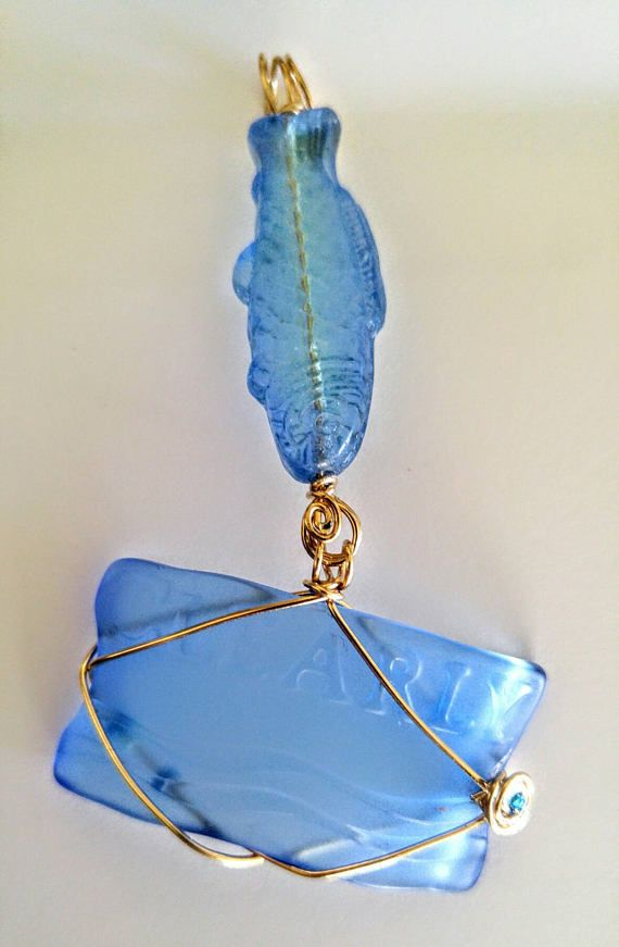 Check out this item in my Etsy shop https://www.etsy.com/listing/533248693/sky-blue-fish-jumping-into-water-pendant
