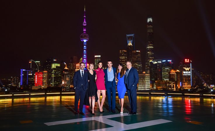 Producers of Warner Bros. Pictures' Wonder Woman Zack Snyder Deborah Snyder Stars Gal Gadot Chris Pine Director Patty Jenkins and producer Charles Roven take in the beautiful Shanghai skyline while on tour in China on May 15 2017.