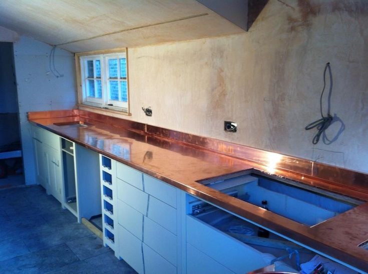 Check out http://zincandcopperworktops.co.uk!  Here are some pictures of previous domestic projects including kitchen worktops and units as well as some photos of how our worktops are manufactured.