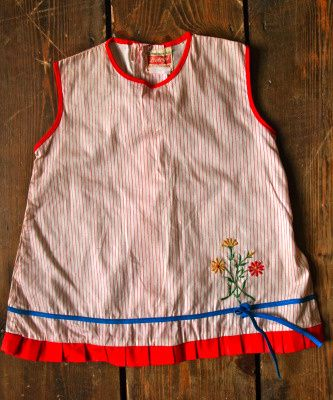Vintage Smock Top 10.00 Cute girl's summer blouse from our selection of vintage clothes for kids.  Great Vintage smock top, in red stripe and embroidered flower. Red trim details with blue ribbon bow.  Good condition  Age 1-2 years  Customise with some of our kids accessories