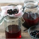 Berries being strained from sloe gin