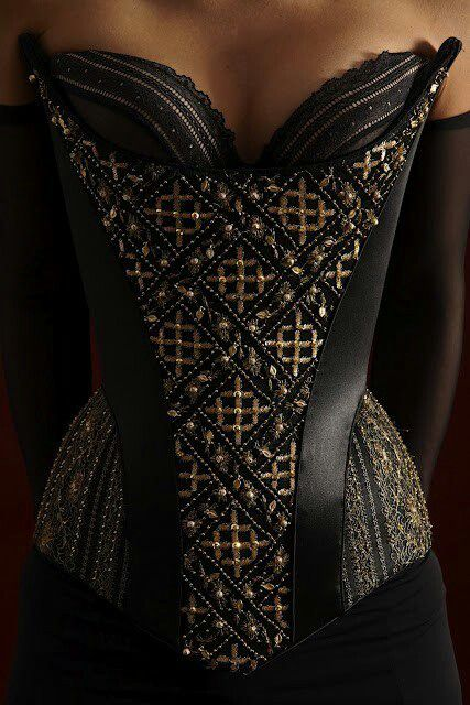 The shape and details of this corset are glorious.