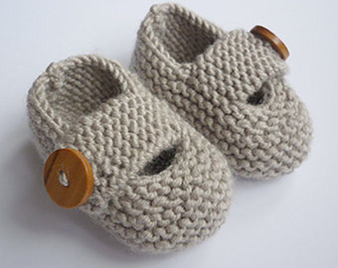 """This is a PDF knitting pattern for button fastening baby booties. They are knit flat and seamed and use double knit weight yarn.You use a circular needle to pick unstitches around the cuff, but still knit back and forth in exactly the same way as you do when using straight needles  Instructions are given for three sizes:  You need to be able to knit, purl and decrease  SIZES: 0 - 3 months - approx length 9cm (3.75""""), 3 - 6 months - approx length 10cm (4.0"""") 6 - 12 months - approx length 11cm…"""