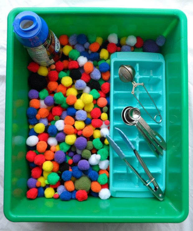 Pom Pom Bin. Great for fine motor skills and introducing and practicing basic math concepts. Plus it's just plain FUN!