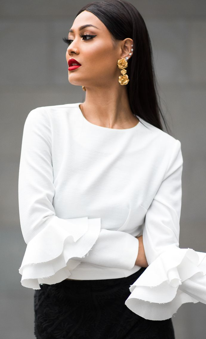 gold floral earrings + white ruffle sleeve blouse + black skirt                                                                                                                                                                                 More