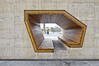 City Square Park, Boston MA. Extruded opening in concrete with wooden inserted bench.