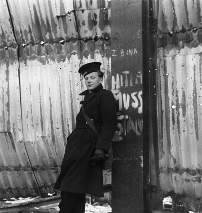 A British sailor on shore leave waits for transport away from the dockside, Harwich, 1941  Beaton, Cecil  © Crown Copyright: IWM (HU 112272)