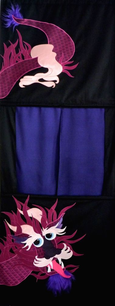 Doorway puppet theatre. Recycled fabric appliqued on a black background.  Fits any standard doorway with an extension rod. Comes with a carrying case. See more PUPPET THEATRES at www.facebook.com/allison.whonewcreations