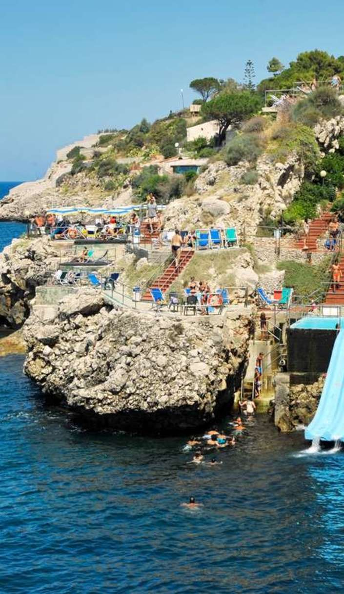 Slide into the Mediterranean Sea at one of the world's coolest water slides Citta Del Mare Hotel Village is Sicily's largest holiday resort.