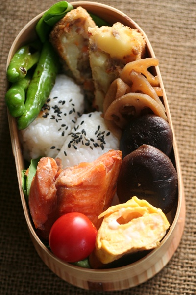 Japanese-Style Bento Lunch|弁当: tamagoyaki, cherry tomato, salted salmon, simmered mushrooms and lotus root, onigiri, blanched or stir fried green beens, and what looks similar to a fish cake (the one with peppers in it)